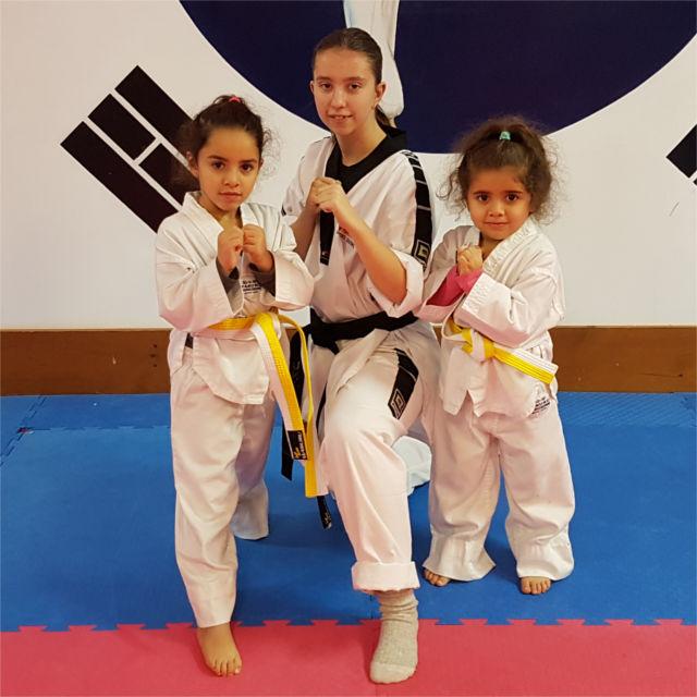 Two ninja pee-wee students with instructor Makayla.
